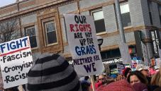Protest sign: Our rights are not up for grabs, neither are we