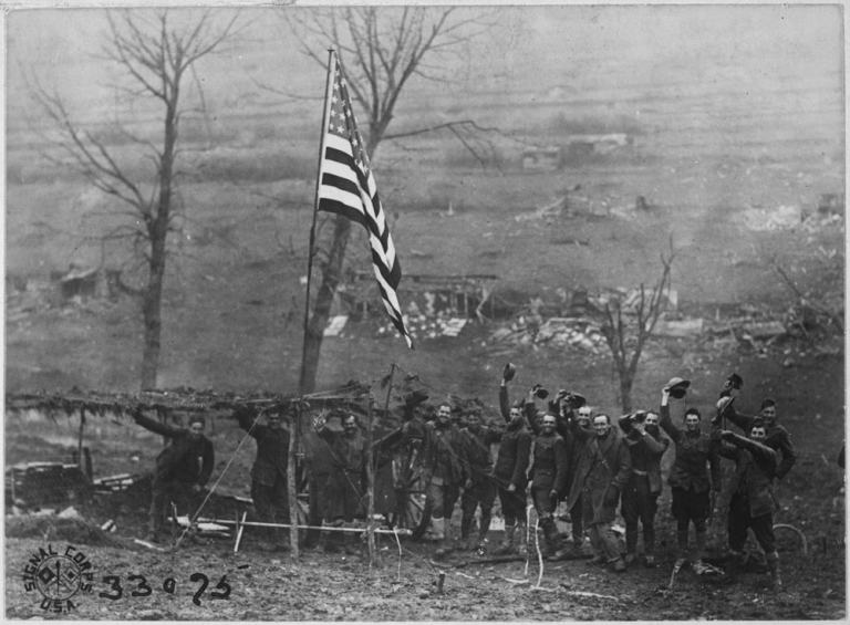 One of the guns of Battery D, 105th Field Artillery, showing American flag which was hoisted after the last shot had been fired when the armistice took effect. Etraye, France., 11/11/1918