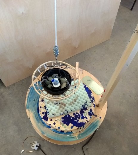 a machine that draws music that you play to it in clay slip and glaze