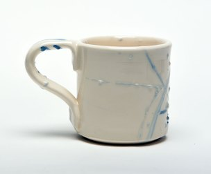 zig zag lines are made by trailing slip from high up on a moving mug