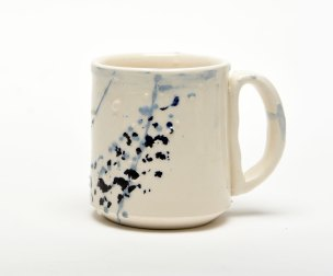 cobalt blue flashes on a white ceramic mug this one could be yours