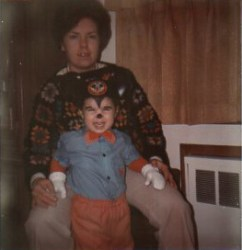 Mom wearing granny square sweater and me dressed as Mickey Mouse in 1973