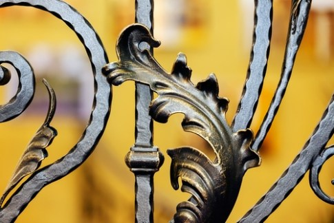 image of architectural detail ornate metal gate, Serbia, demonstrating home organizer value of excellent craftsmanship