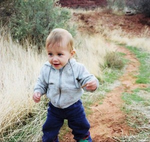 dale Stephens as a baby beginning walking on a hiking trail.
