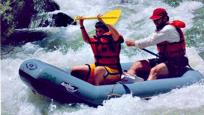 Dale Stephens and his father rafting on Cache Creek.