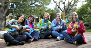 Group of unschool moms playing ukulele