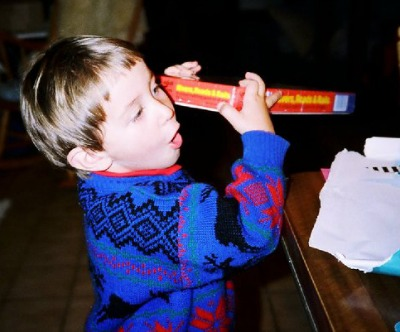 Dale Stephens as a child in awe opening gift, Thiel Tip #10 Gratitude at www.LisaNalbone.com