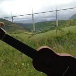 Ukulele with Millau Viaduct in bacdground. original photo by Lisa Nalbone at LisaNalbone.com