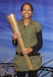 lISA HOLDING OLYMPIC TORCH