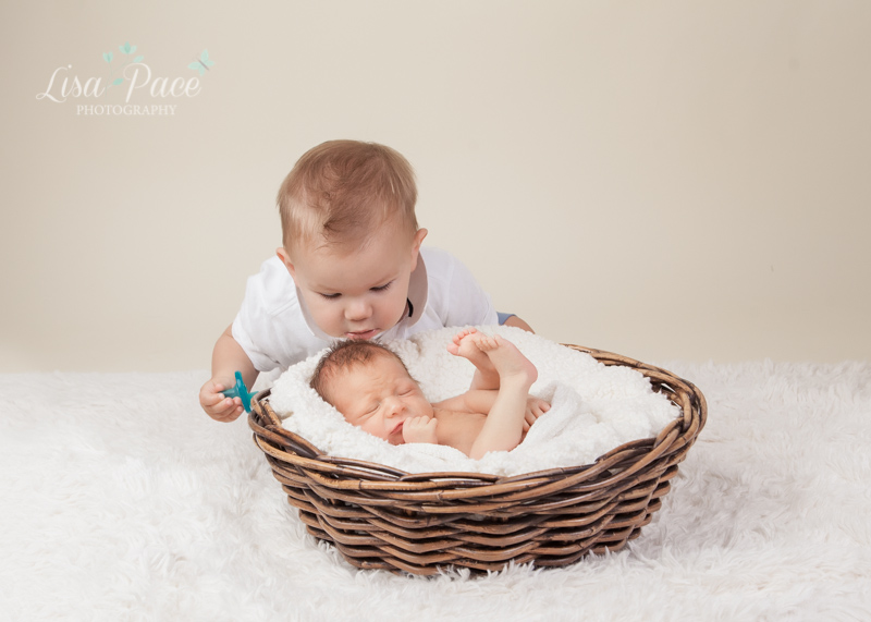 big brother giving baby a kiss