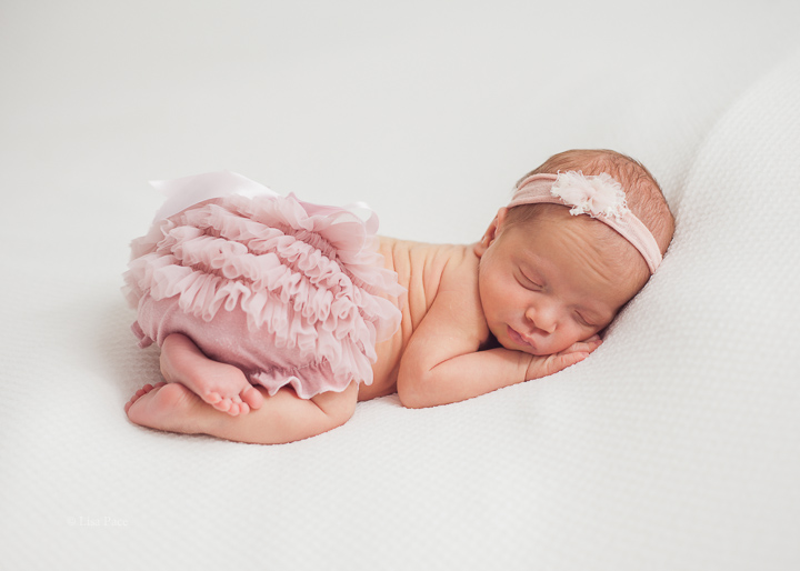 newborn baby girl sleeping with bum up in air