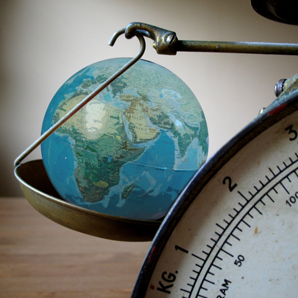 A scale weighs the Earth. (Photos © FreeImages/Pontus Edenberg and Edu Wagtelenberg)