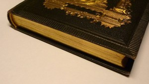 Old_book_with_gilded_page_edges