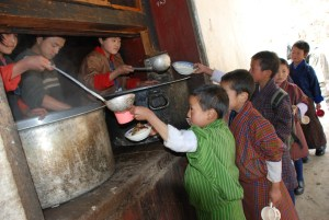School Children line up for their midday meal.