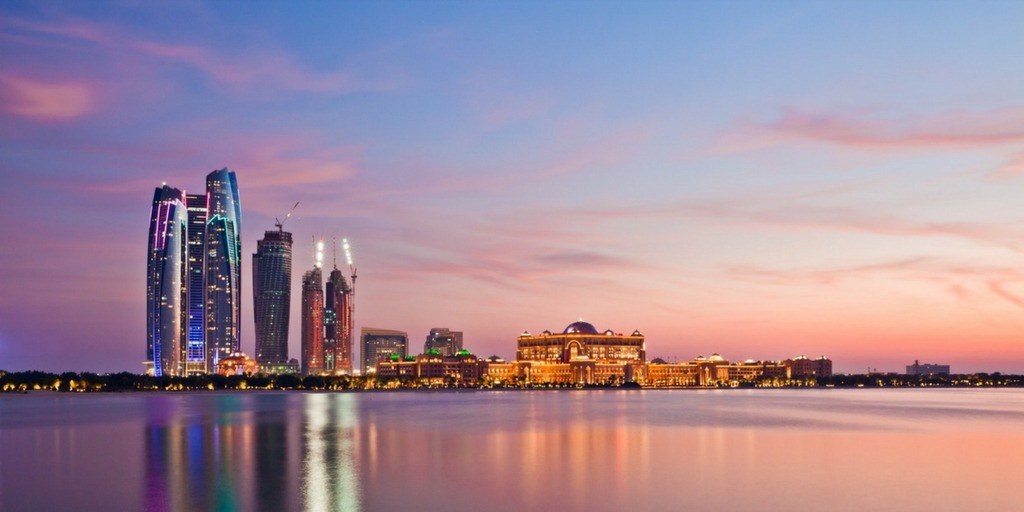 Abu Dhabi City skyline of Ethiad Towers and Emirates Palace | Little City Trips Guide how to get around Abu Dhabi