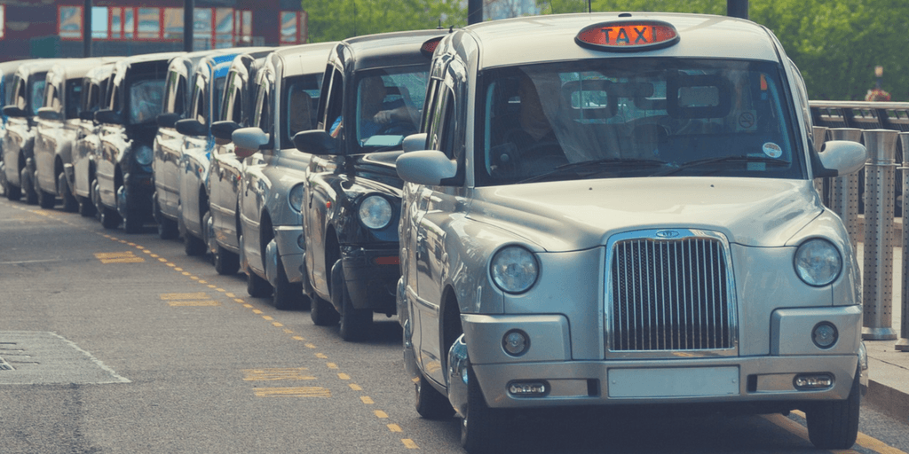 London black cabs lined up | How to get around London with Kids | London City Guide by Little City Trips