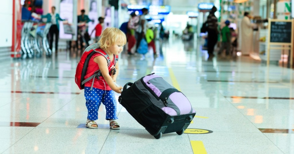 Child pulling a suitcase -best travel products