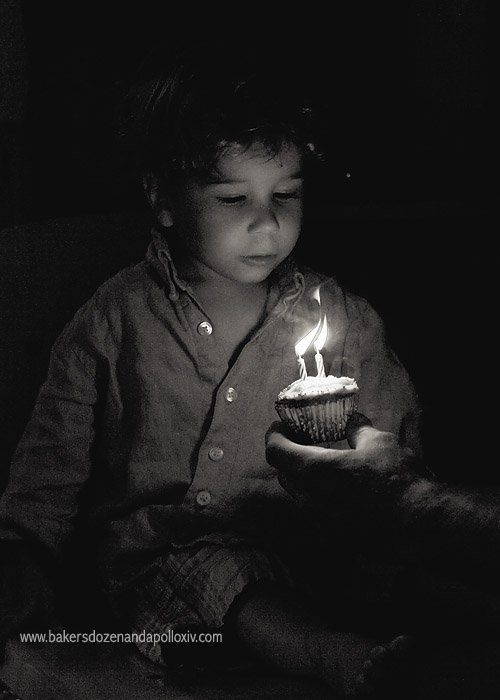 Apollo blowing out birthday candles.