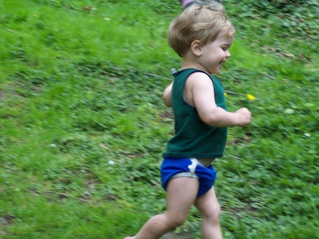 Toddler running in cloth diaper.