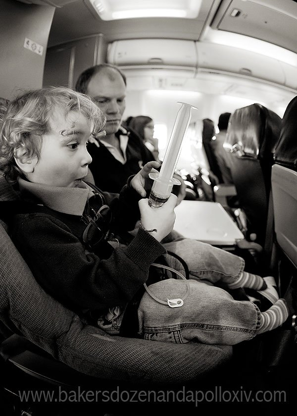 Toddler using g-tube on airplane. Traving to texas to get double aortic arch repair.