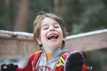 smiling boy eating snow