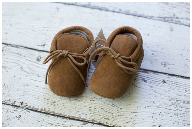 Tiny baby shoes. How to be minimalist with a large family.