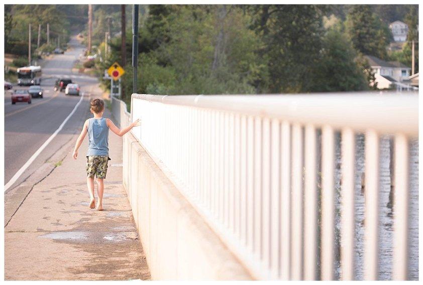 Apollo walking on a bridge.