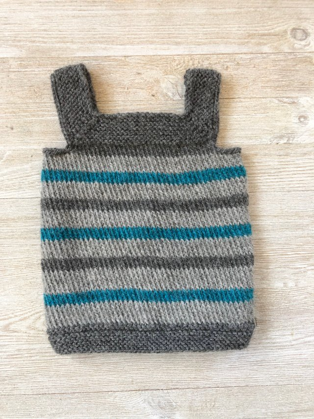 This baby vest was hand knit for Tilly's baby out of alpaca wool.