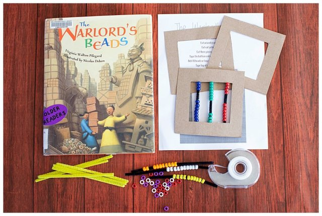Supplies laid out for The Warlord's Beads math activity.