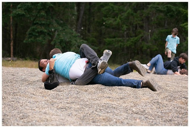 Mordecai and Enoch wrestling in the dirt.