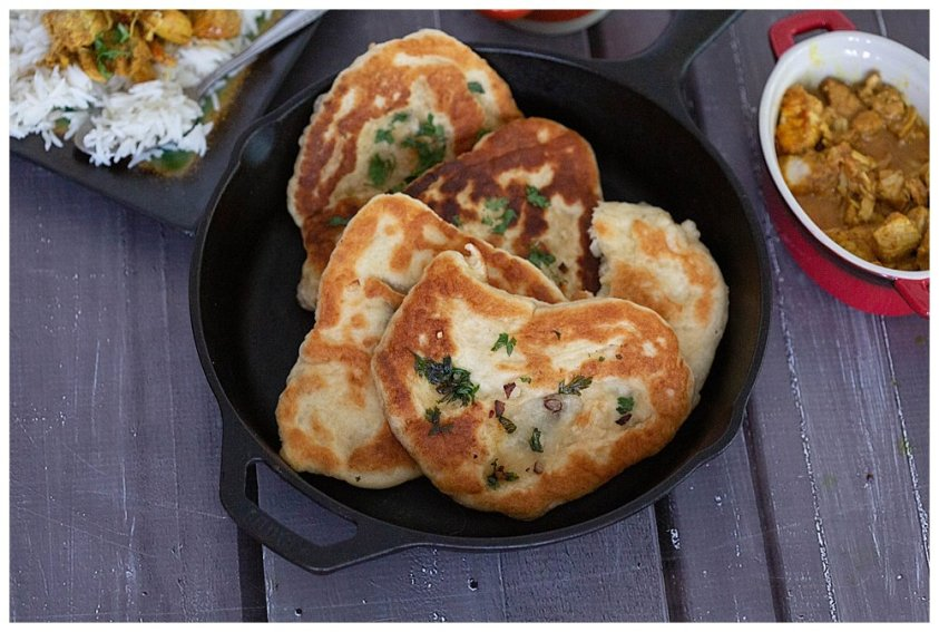 Sprinkle naan bread with cilantro.