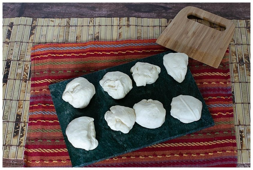Divide the naan dough into eight equal pieces.