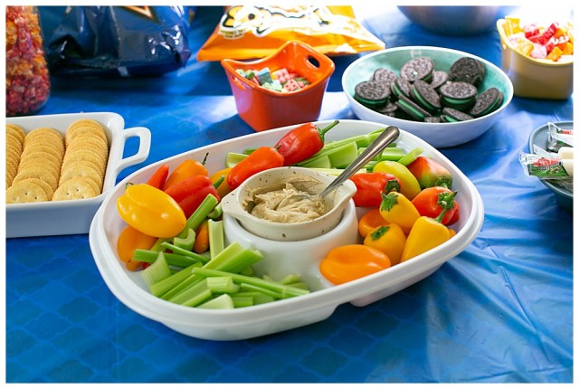 Colorful veggie tray at LEGO movie themed party.