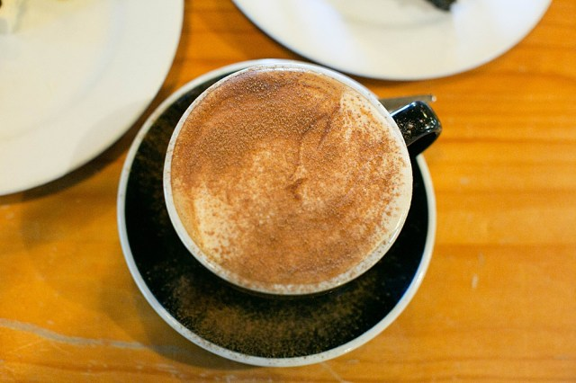 Drinking a cappuccino in a cafe in New Zealand.