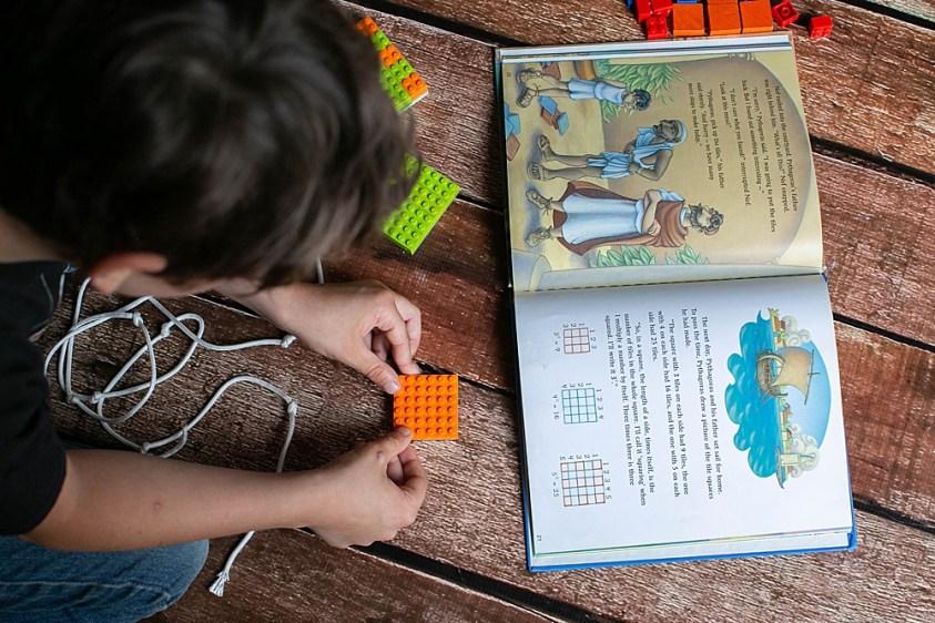 Apollo proving the Pythagorean Theorem using LEGO.