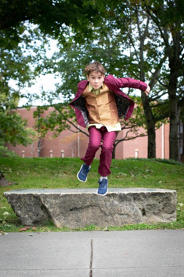 Boy dressed as Arthur Fleck in easy joker-inspired costume.