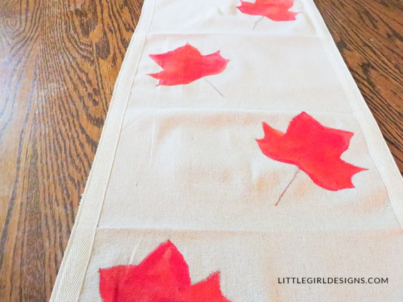 This fall table runner is so pretty and simple to make! Turn on a movie, paint and stitch away, and you'll have a lovely table runner for fall.