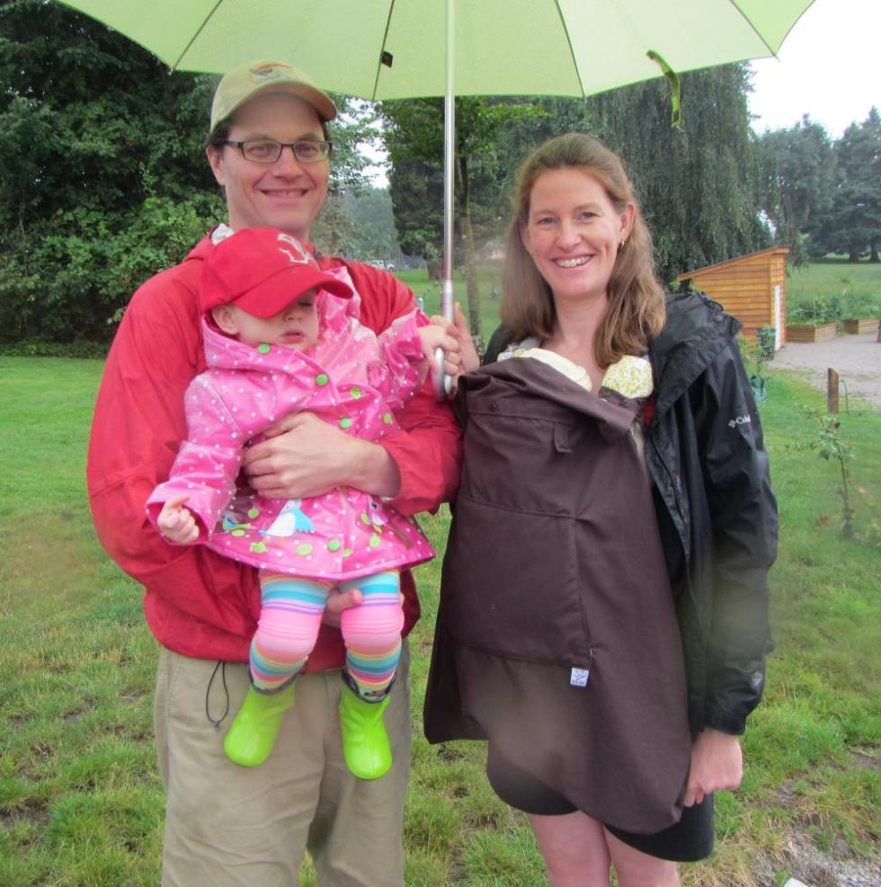 family outing with rain cover