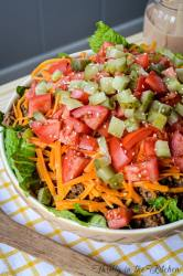 Forget Drive Thru! Try this yummy and healthy Deluxe Cheeseburger Salad! Romaine lettuce is topped with all your favorite Deluxe Cheeseburger toppings for an easy, quick, and healthy meal.