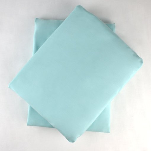ethical sheets in an aquamarine colour organic cotton, view from above