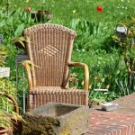 Garden with a relaxing wicker chair