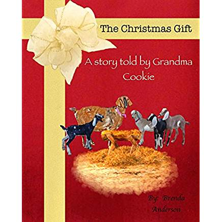 The Christmas Gift a story told by Grandma Cookie, Red book with a manger sitting in straw. 4 goat kids stand around a grandma goat, Grandma Cookie, by Brenda Anderson