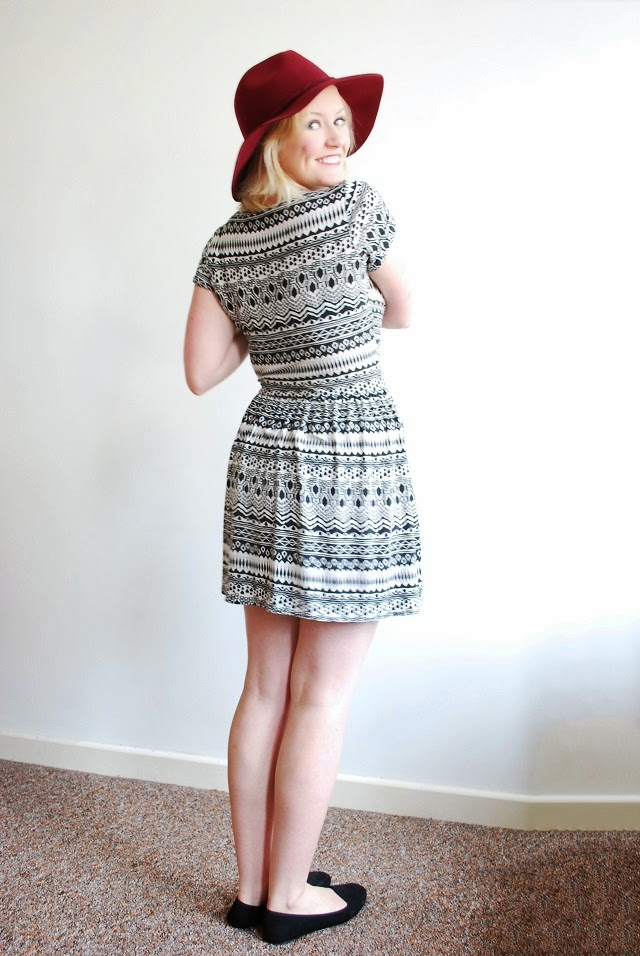 Little Miss Katy OOTD back shot of monochrome aztec dress and hat