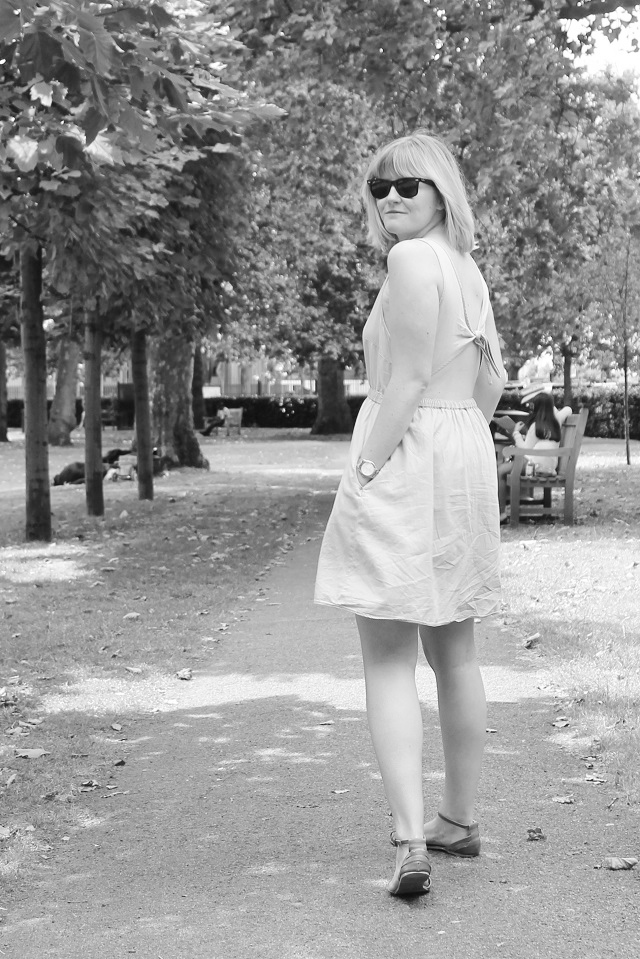 Backshot of Katy walking away in black and white