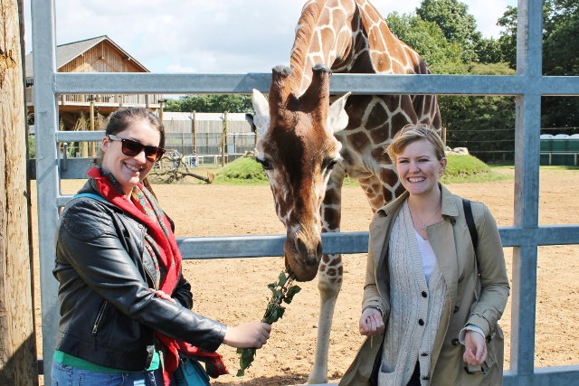 Katy and Shvonne with a giraffe