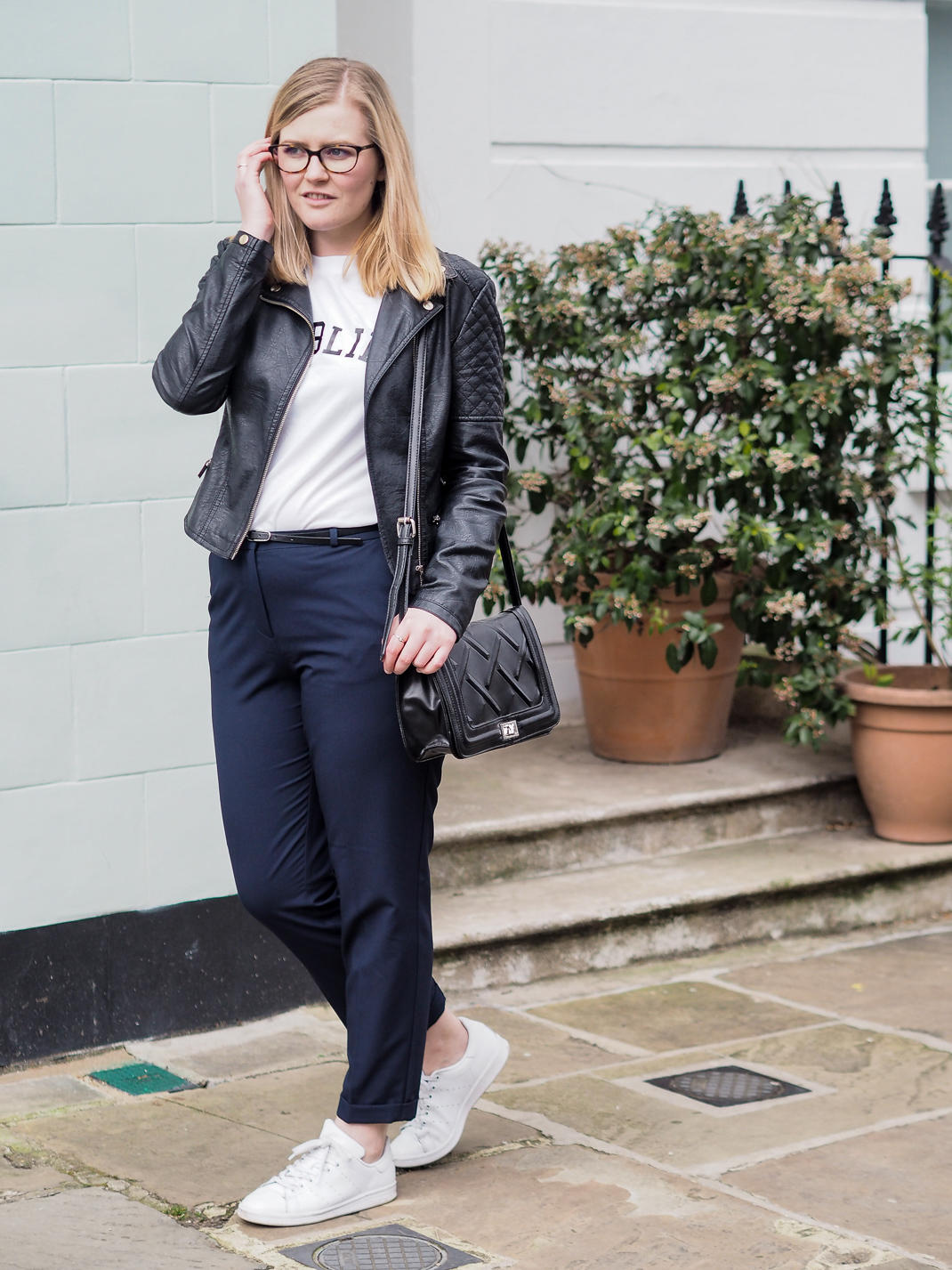 casual outfit: trousers, tshirt, leather jacket, trainers.
