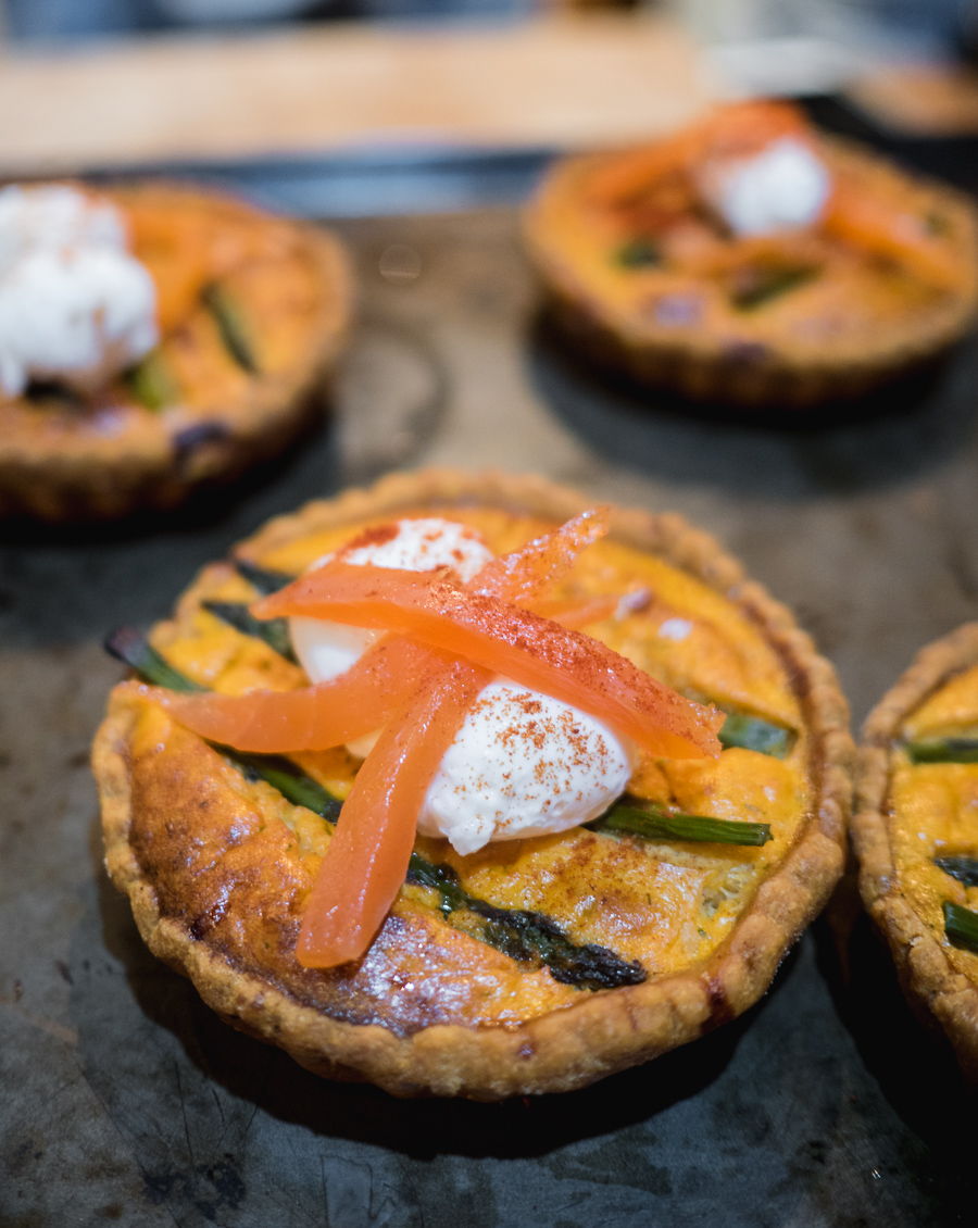 smoked salmon and asparagus tart with poached quails egg