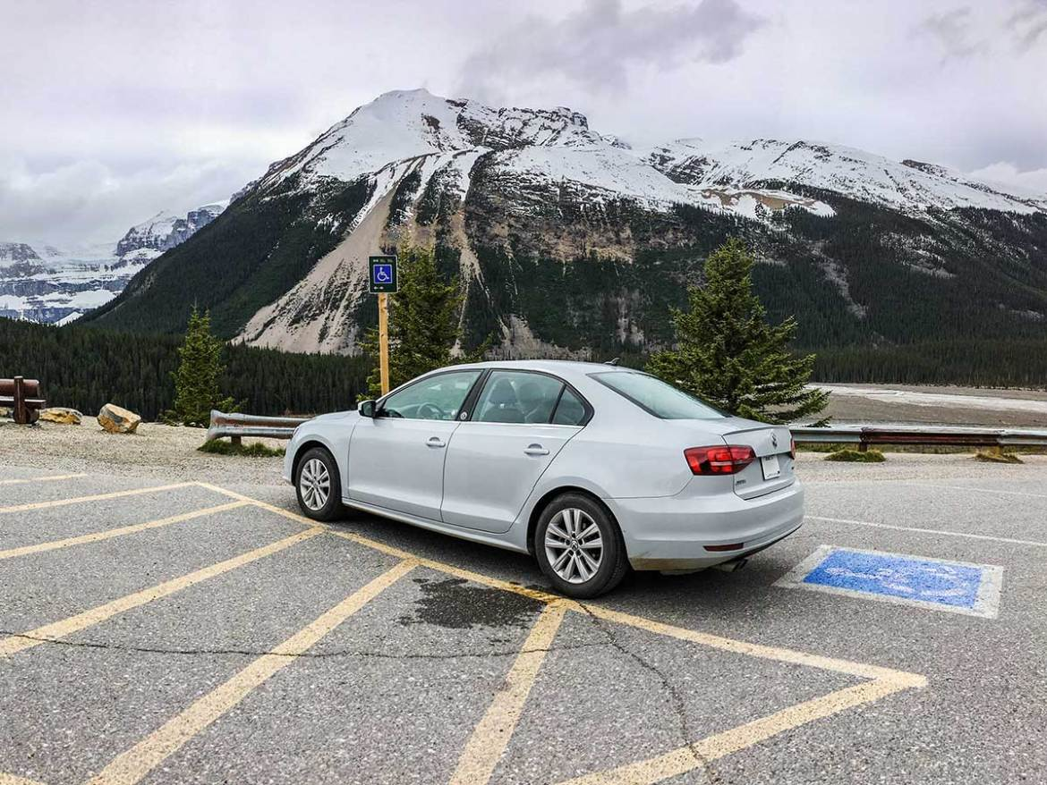 Rental car parks on handicap parking in Banff National Park