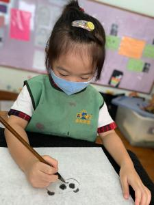 Preschool children practicing calligraphy on a weekly basis. Helps to nurture patience in children. Build their confidence and develop eye hand coordination in young children. learn the proper way of holding paint brush. improve fine motor skills.