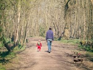 dad and toddler walking